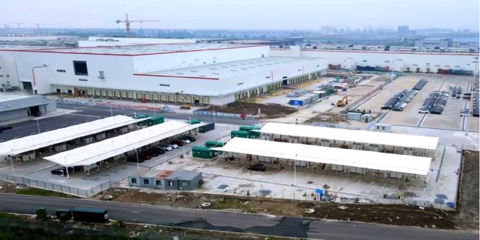 Musk confirms that Tesla has paid off its $1.4 billion China Gigafactory loan early.
